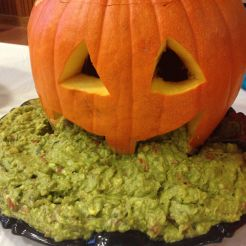 Holy puking pumpkin! One of the tasty dishes in Thousand Oaks Public Elementary Fall festival. Somebody really made the carved pumpkin face puking guacamole - ugly, funny and very tasty.