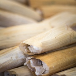 The tamales were piled on the table. There were numerous, I didn't count but must be several hundreds stacked all over the tables in the teachers office.