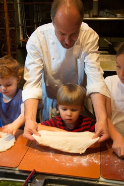 Head chef Miles shows to our sous chefs how to mold the real Jupiter style pizza crust.