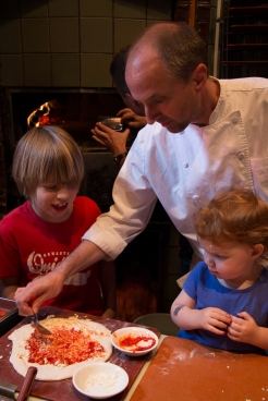 Miles' own sous chefs made their favorite pizza with some tomato sauce in it.